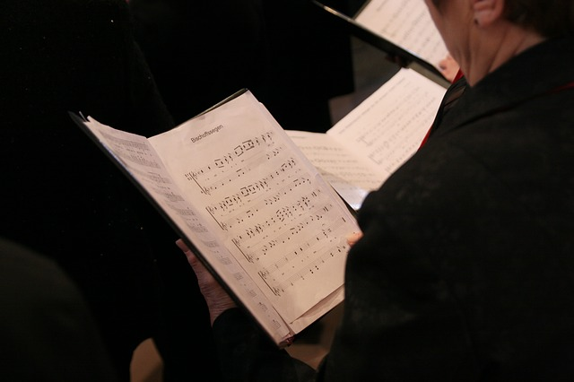 a choir singer with a songbook