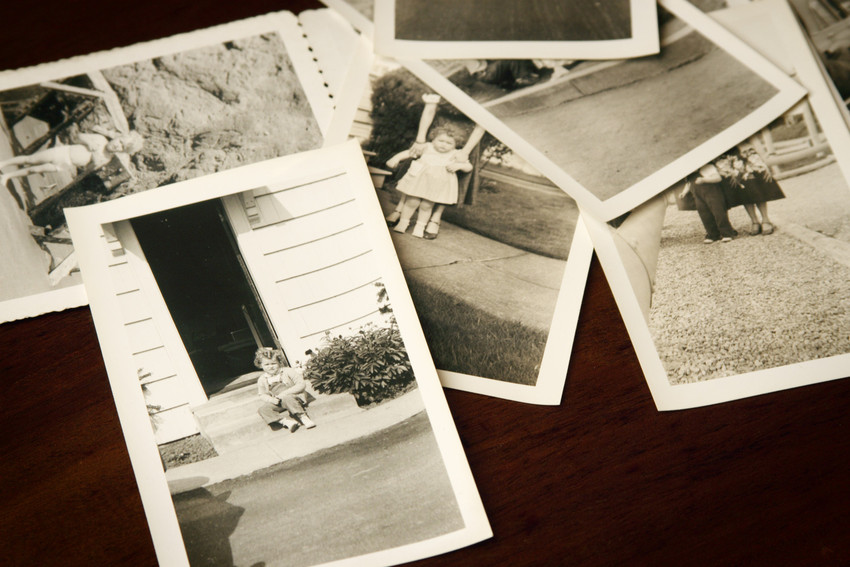 a stack of old photos
