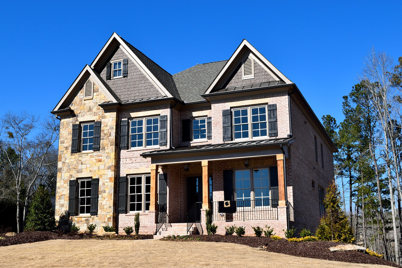 Two-story suburban home with brick stucco exterior.